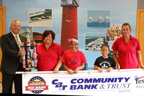 Members of Buccaneers receive their Third Place trophy for their entry in the 2014 Sheboygan Fourth of July parade.