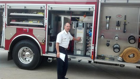 Assistant Fire Chief Leroy Skarloken shows of the Fargo Fire Department's new rescue pumper truck