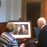 Dr Robert Browne is presented with a portrait of himself and his late wife Lynn by Phyllis Snyder at the Henry L.Browne Municipal Building in Coldwater on July 10, 2014