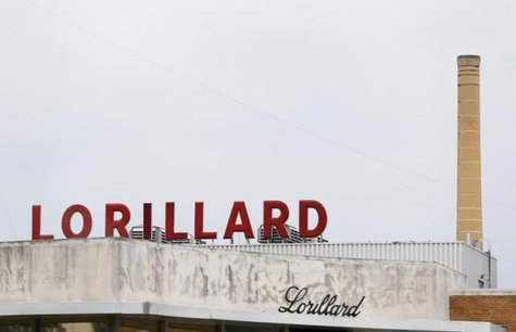 The Lorillard corporate sign is seen atop their cigarette manufacturing plant in Greensboro, North Carolina May 23, 2014. CREDIT: REUTERS/CHRIS KEANE