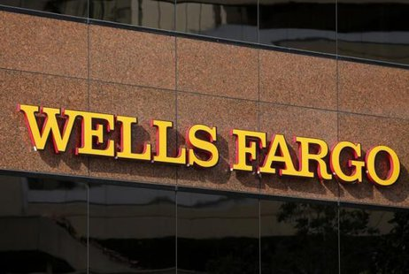 The logo on a Wells Fargo bank building is seen in downtown San Diego, California March 18, 2014. CREDIT: REUTERS/MIKE BLAKE