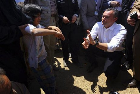 Nickolay Mladenov, the United Nations Secretary-General Special Representative for Iraq, visits a Iraqi refugee camp on the outskirts of Arbil in Iraq's Kurdistan region June 14, 2014. CREDIT: REUTERS/STRINGER