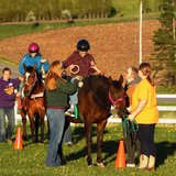 Staff working with patients at Stable Hands Equine Therapy, Wausau WI.  Photo: Stable Hands Equine Therapy LLC.