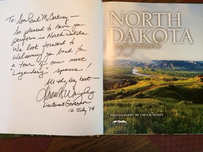 Commemorative North Dakota book presented to Paul McCartney in Fargo. July 12, 2014.