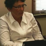 Coldwater Superintendent Dr Tina Kerr at school board meeting July 14, 2014