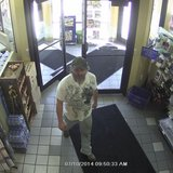 Surveillance photo of man in puppy case at an Oshkosh truck stop (Photo from: Oshkosh Police Department).