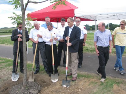 Stevens Point and Canadian National Railroad officials plant the first tree as part of a CN grant program