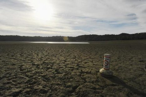 A buoy meant for boaters rests on the dry bed of Lake Mendocino, in California February 25, 2014. Credit: Reuters/Noah Berger
