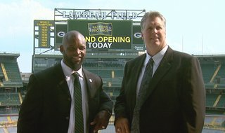 Ahman Green and Ken Ruettgers pose for pictures prior to their induction into the Green Bay Packers Hall of Fame. (Photo from: FOX 11).