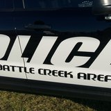 Battle Creek police took the mother into custody.  The boy had bruises and marks where he had been struck.