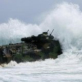 A U.S. Marine Corps amphibious assault vehicle charges through the surf at the Marine Corps Base Hawaii during the multi-national military exercise RIMPAC in Kaneohe, Hawaii, July 9, 2014. CREDIT: REUTERS/HUGH GENTRY