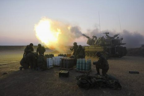An Israeli mobile artillery unit fires towards the Gaza Strip July 21, 2014.  CREDIT: REUTERS/NIR ELIAS