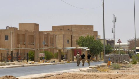 Iraqi soldiers walk in Tikrit University, where Iraqi special forces clashed with fighters from the Islamic State in Iraq and the Levant (ISIL) last month, July 18, 2014. CREDIT: REUTERS/STRINGER