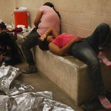 Immigrants who have been caught crossing the border illegally are housed inside the McAllen Border Patrol Station in McAllen, Texas July 15, 2014, where they are processed. CREDIT: REUTERS/ RICK LOOMIS/POOL