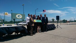 Mike McCarthy Way street sign unveiled during ceremony outside Green Bay Distillery in Ashwaubenon on July 23, 2014. (Photo Copyright Midwest Communications, Inc.)
