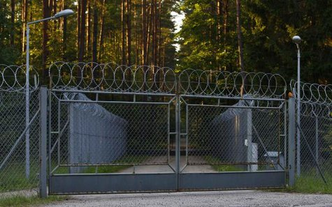 A barbed wire fence surrounding a military area is pictured in the forest in Stare Kiejkuty village in northeastern Poland, in this August 16, 2013 file photo. The CIA ran a secret jail on Polish soil, the European Court of Human Rights ruled on July 24, 2014, a decision that puts pressure on the United States and its allies to reveal the truth about the global programme for detaining al Qaeda suspects.  REUTERS/Kacper Pempel/Files