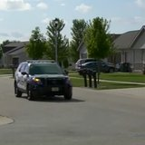 A Fond du Lac Police squad car searches for a naked intruder on July 23, 2014. (Photo from: FOX 11/YouTube).