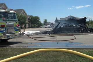 The smoldering remains of a garage after a fire in the town of Menasha, July 24, 2014. (Photo from: FOX 11).