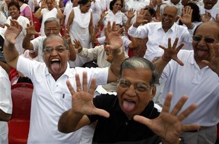 Members of laughter club participate in a laughing exercise in Mumbai May 4, 2008. CREDIT: REUTERS/PUNIT PARANJPE