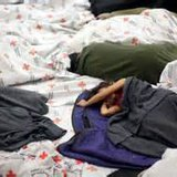 Immigrant children sleeping in a holding cell