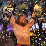 Daniel Bryan celebrating with the WWE World Heavyweight Championship at WrestleMania XXX on April 6, 2014. (Photo By Megan Elice Meadows (IMG_5217) [CC-BY-SA-2.0 (http://creativecommons.org/licenses/by-sa/2.0)], via Wikimedia Commons).