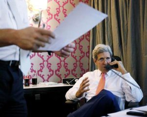 U.S. Secretary of State John Kerry speaks on the phone to Israeli Prime Minister Benjamin Netanyahu about the terms of a ceasefire in Israel's fight against Islamist militants in Gaza, from his hotel suite in Cairo July 25, 2014. REUTERS/Pool