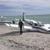 First responders respond at the scene of a single engine Piper Cherokee plane crash in this photo provided by the Sarasota County Sheriff's Office in Caspersen Beach in Venice, Florida July 27, 2014. CREDIT: REUTERS/SARASOTA COUNTY SHERIFF'S OFFICE/HANDOUT