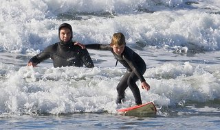 "Father and son surf lesson in Morro Bay, CA. (Photo by ""Mike"" Michael L. Baird [CC-BY-2.0 (http://creativecommons.org/licenses/by/2.0)], via Wikimedia Commons)"