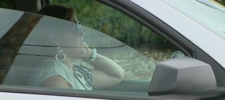 A woman talks on her cell phone while driving. (Photo from: FOX 11/YouTube).