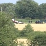 Authorities respond to a small plane crash in a field near the state prison in the Town of Oshkosh on July 30, 2014. (Photo from: FOX 11/YouTube).