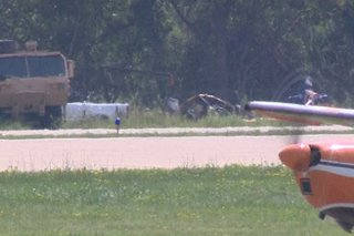 A crashed plane is towed away from Wittman Regional Airport in Oshkosh, July 31, 2014. (Photo from: FOX 11).