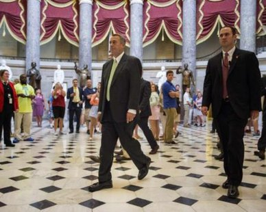Speaker of the House John Boehner (R-OH) walks from his office to the House Chamber during a procedural vote at the Capitol in Washington August 1, 2014. REUTERS/Joshua Roberts
