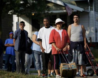 Local residents wait in line to receive drinking water outside Waite High School in Toledo, Ohio August 3, 2014. REUTERS/JOSHUA LOTT