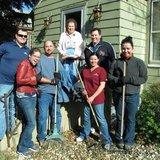 Student volunteers rake leaves; a job too big for some elderly. (globeuniversity.edu)