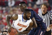Florida Gators center Patric Young (4) drives against Connecticut Huskies center Amida Brimah (35) in the first half during the semifinals of the Final Four in the 2014 NCAA Mens Division I: REUTERS/Robert Deutsch-USA TODAY