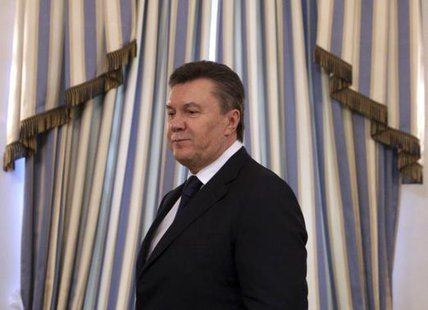 Then Ukrainian President Viktor Yanukovich arrives to sign an EU-mediated peace deal with opposition leaders at the presidential headquarters in Kiev in this February 21, 2014 file photo. CREDIT: REUTERS/KONSTANTIN CHERNICHKIN/FILES