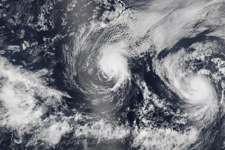 Hurricane Iselle and Hurricane Julio (R) are pictured en route to Hawaii in this August 5, 2014 NASA handout satellite image. CREDIT: REUTERS/NASA/HANDOUT VIA REUTERS