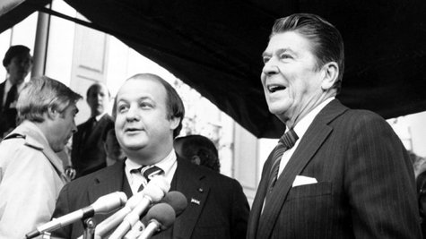Archived photo of Ronald Reagan and his press secretary James Brady
