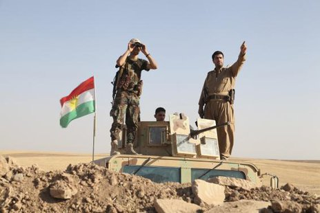 Kurdish peshmerga troops participate in an intensive security deployment against Islamic State militants on the front line in Khazer August 8, 2014. Credit: Reuters/Azad Lashkari