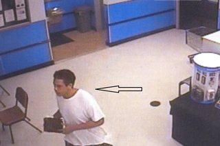 This surveillance image released by the Oshkosh Police Dept. shows the suspect in a July 22, 2014 theft from Walmart. (Photo from: Oshkosh Police).