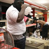 A man armed with a gun in his waistband takes items inside the QuikTrip convenience store in Ferguson, Missouri August 10, 2014.  CREDIT: REUTERS/DAVID CARSON/ST. LOUIS POST-DISPATCH/MCT