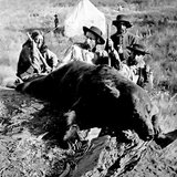 General George A. Custer with a Grizzly Bear he had just shot.  This photo was taken in 1874 by English photographer William H. Illingworth. (news.sd.gov)