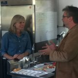 Mary Burke and Brian Gunning of Wausome Foods discussing small business issues.  Photo: WSAU
