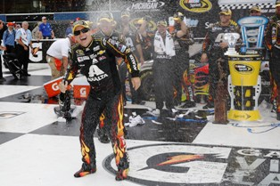Jeff Gordon celebrates in the Winners Circle after capturing the Pure Michigan 400 at Michigan International Speedway August 17, 2014