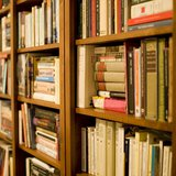A bookshelf. Image by Stewart Butterfield, via Wikimedia.