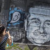 A woman takes a picture of a mural depicting late actor Robin Williams in Belgrade, August 13, 2014.  Credit: Reuters/Marko Djurica