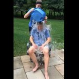 Governor Rick Snyder getting ice water dumped on his head.