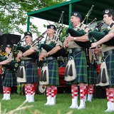 A bagpipe band. Image by Albert Herring, via Wikimedia.