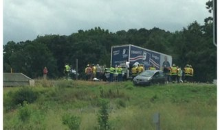 Emergency crews work at the scene of a crash on U.S. Highway 41 at State Highway 55 in Kaukauna on Aug. 20, 2014. (Photo from: FOX 11).