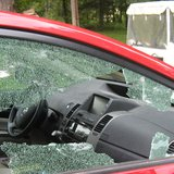 broken car window file photo